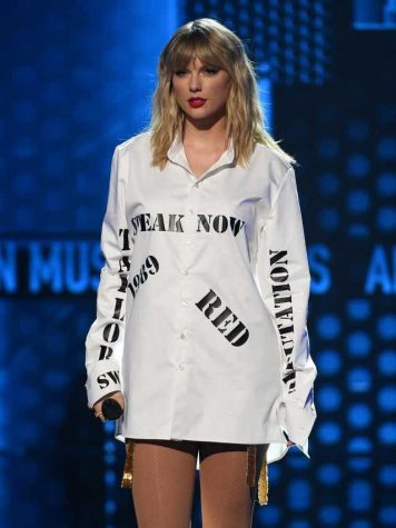 """Swift at the 2019 AMAs, wearing her """"stolen lullabies"""" amidst the scandal over ownership of her masters."""