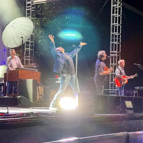 The band performing their song Rain King